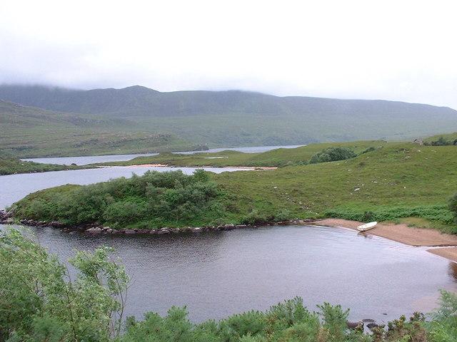 boat on sandy shore of Loch Lugainn (west)