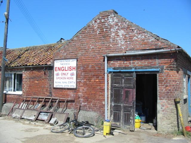 Farm buildings at Salton Lodge with sign displaying anti EEC feelings