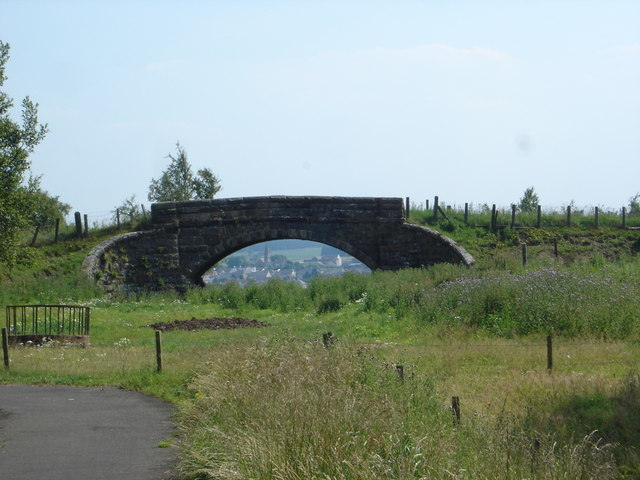 View of Harthill through bridge over former mineral railway