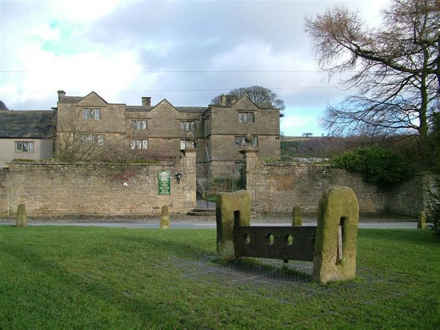 Eyam Hall and the village stocks