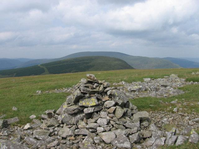Summit cairn of Meikle Millyea looking towards Milldown
