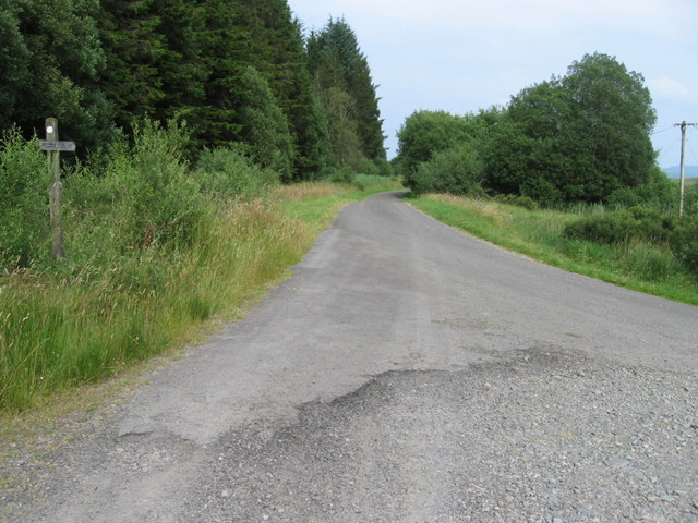 The Southern Upland Way joins the tarmac road near Drumbuie