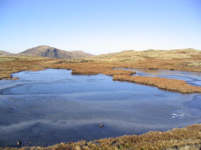 A frozen over Fuffock Lochan near Drigmorn Hill