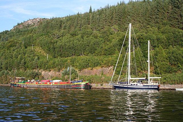 Pleasure craft at rest under Craig a Ghiubhais, Loch Ness.