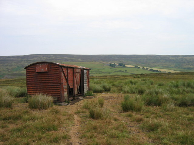 Old railway goods wagon used for winter food on Stanhope Common