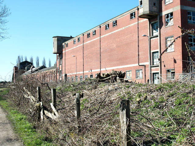 Disused Maltings next to the railway at Milford Junction.