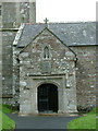 SX2397 : Week St Mary Church porch by Neil Lewin