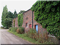 SJ3676 : Old barn, Sutton New Hall by Peter Craine
