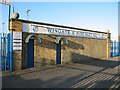 Dist:0.2km<br/>Entrance to the Wingate & Finchley Football Club on Summers Lane.  The club is currently in Northern Division 1 of the Ryman League also known as the Isthmian League.  The club's fascinating history is detailed on wikipedia.  Go inside to see a match [[[236661]]]