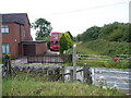 SK0253 : Level crossing by Roger W Haworth