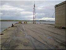 Q7314 : Fenit Harbour Pier by Nigel Cox