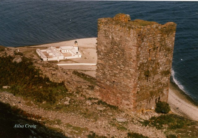 Castle on Ailsa Craig, lighthouse below on shore.