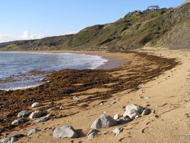 Eastern end of Ringstead Bay shingle beach