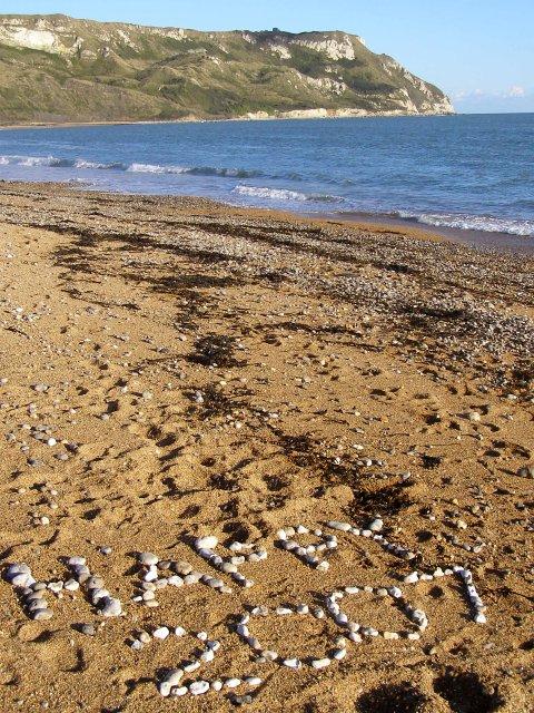 Written in stones on Ringstead Beach
