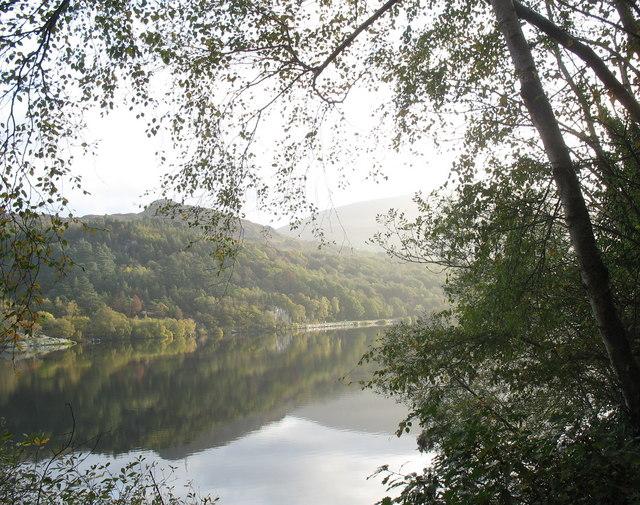 The reflection of Y Bigil in the still waters of Llyn Padarn