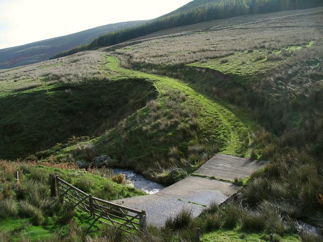 Concrete bridge and mountain track