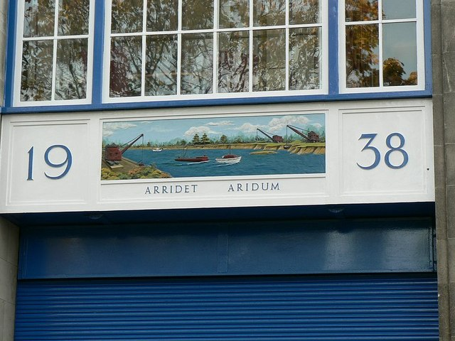 Decoration and Latin motto above the door, River House