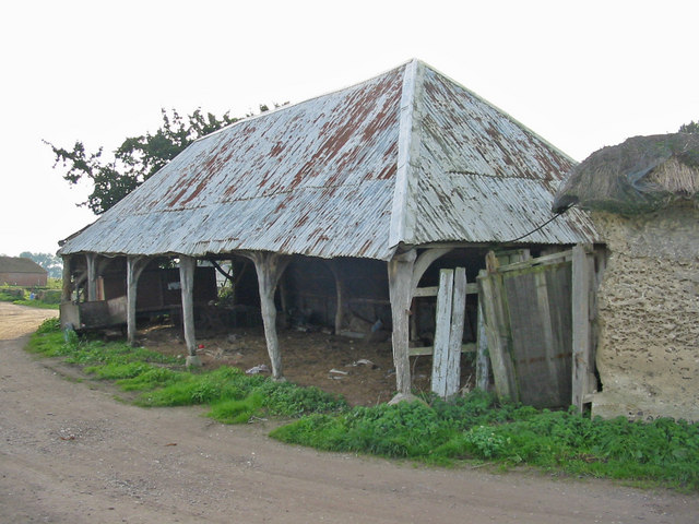 Old cart shed with modern roof