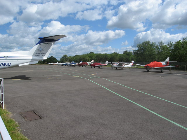 Line up of resident aircraft by the eastern fence at Blackbushe