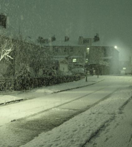 Snow falling on Edgar Street, Huncoat, at night