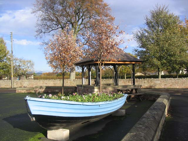 Flower bed boat and shelter in the village of Horncliffe