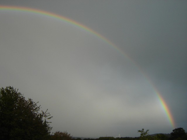 Rainbow over cement factory