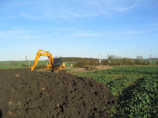 Muck heap and excavator