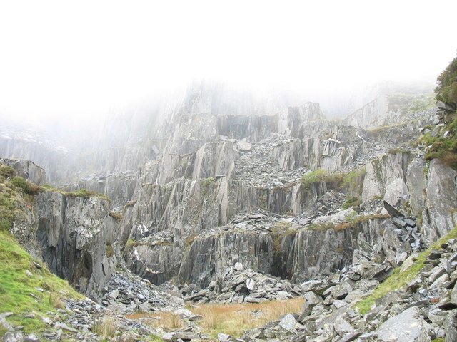 Mist engulfs the top galleries of Gorseddau Quarry