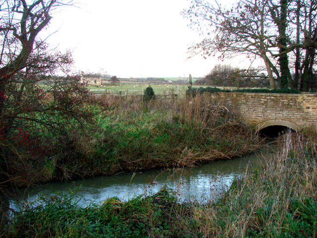 Bridge over Cock Beck, with Lead Parish Church visible in the distance.