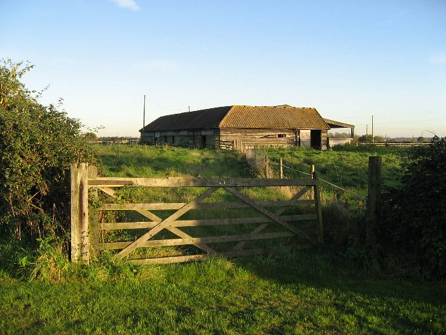 A Wooden Gate And Barn