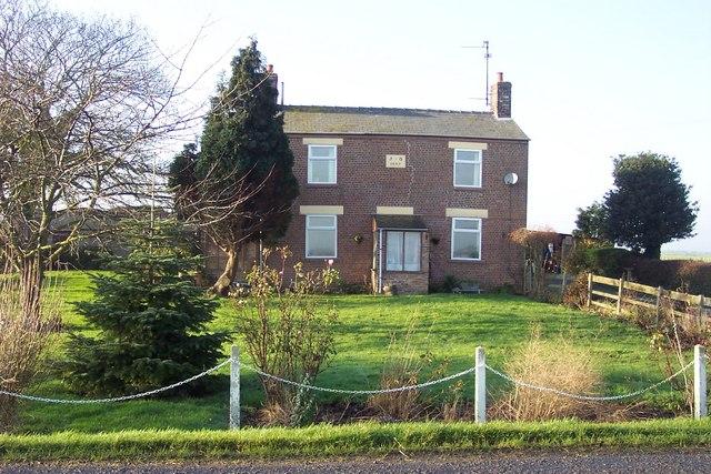 Brick cottage opposite Eye Farm