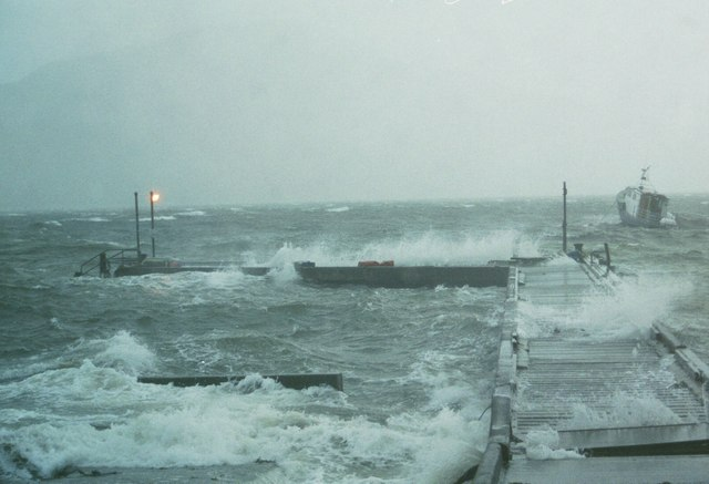Old Inverie pier (now demolished) suffering a November storm battering