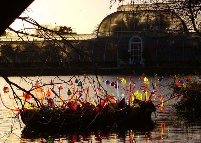 Chihuly glass in boat, sun behind the Palm House