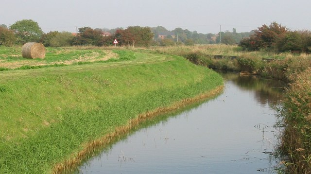 Marsh drain, looking towards dune coastal village