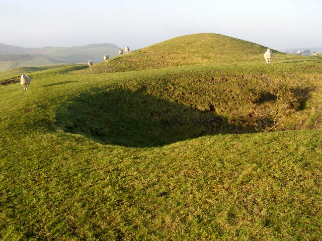 Holes and barrows on Bronkham Hill