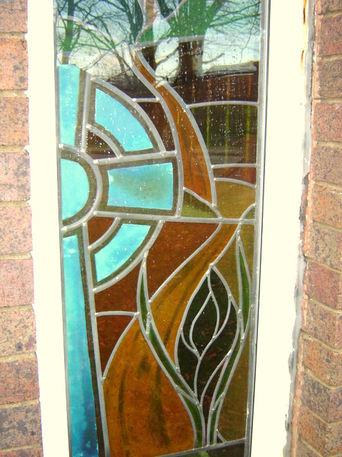 Stained glass window in youth centre in Mold