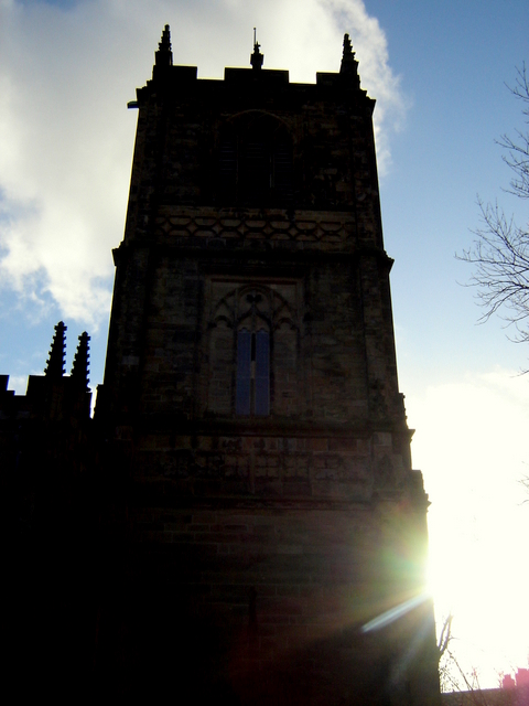 The church tower at St Mary's church, Mold, in silhouette