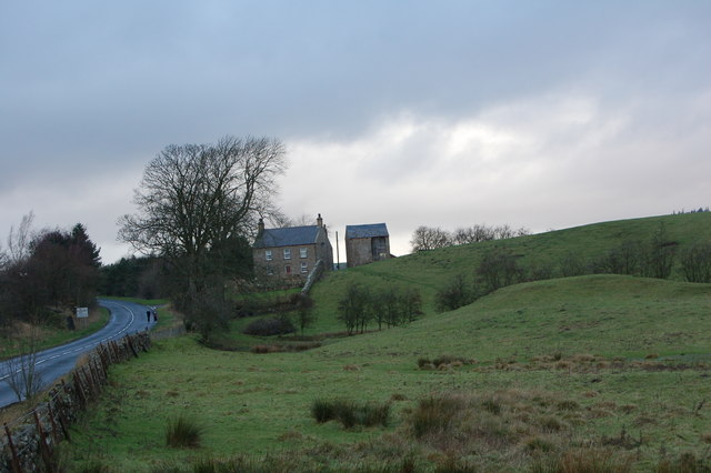 House with tall barn near Thirlwall Castle