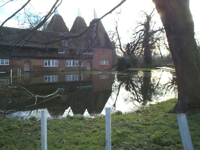 Oast house by the Nailbourne, Littlebourne