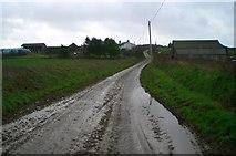 SW9445 : View south down muddy road to Furda by Kieran Evans