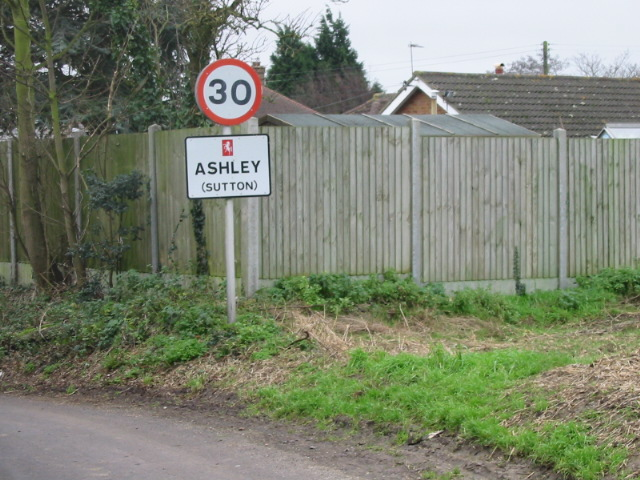 Road sign for the village of Ashley.