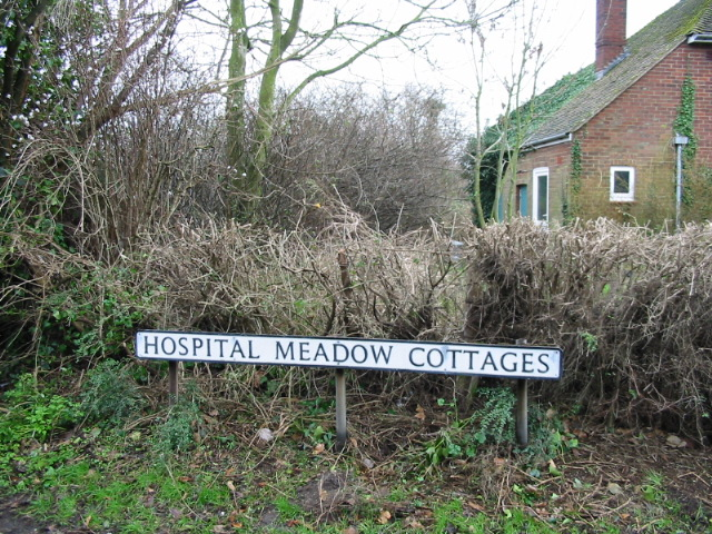 Hospital Meadow Cottages, sign.