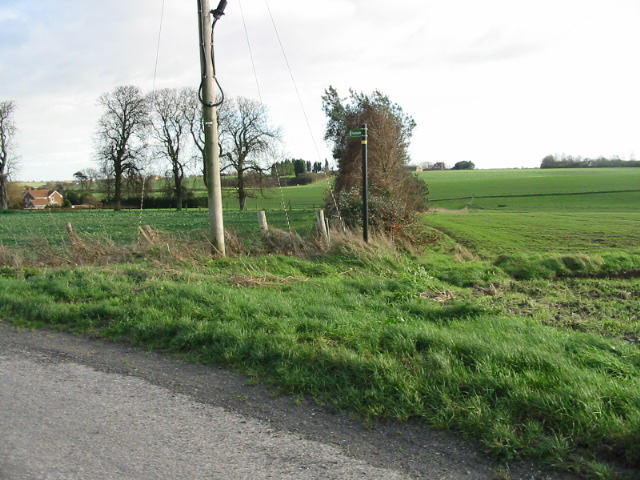 View of farmland and footpath sign.