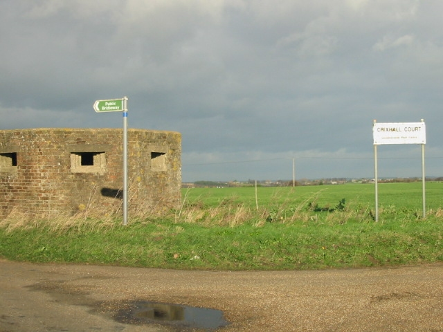 Pill box and signs at junction of Buckland Lane and Crixhall Court track