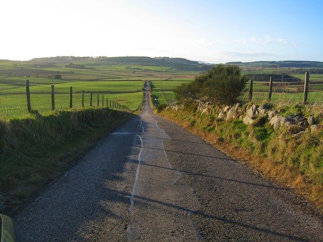 Long Straight Road leading past Tulloch looking towards Westhill