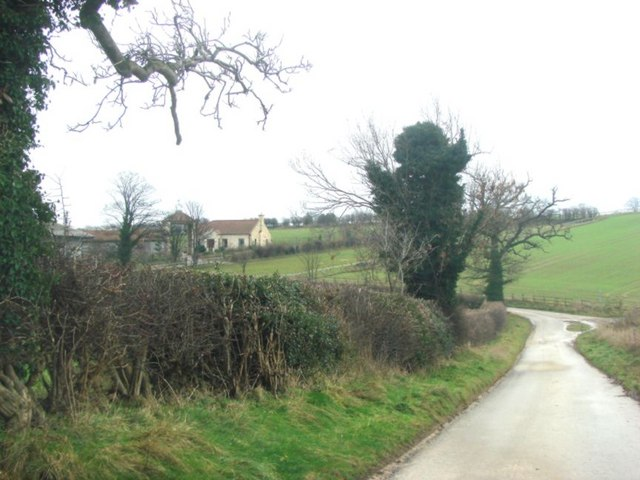Road from West Woods farm, with Lane side Farm in the background
