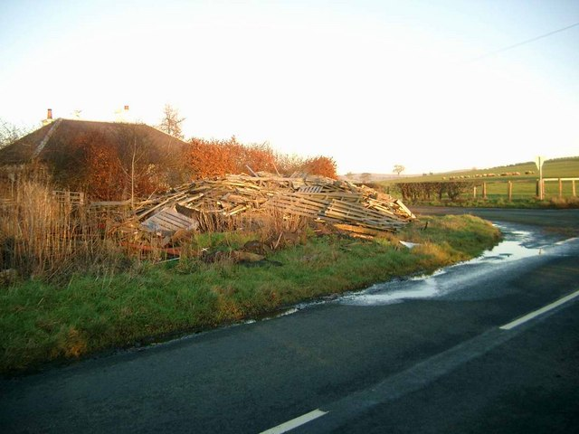 Road junction with waste wood pile