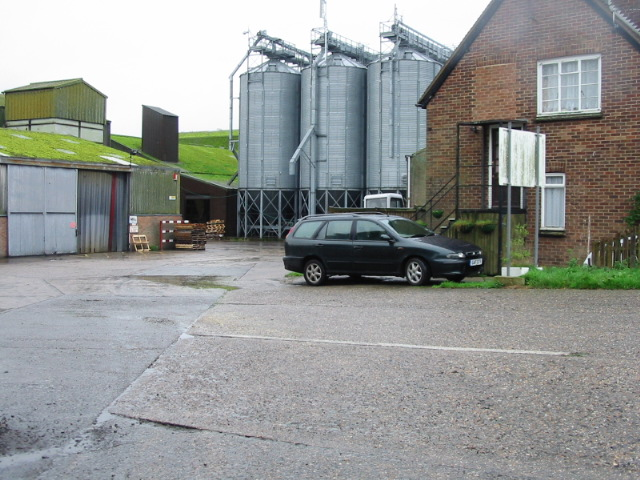 Grain silos and moss covered roof 'Grain Harvesters Ltd'