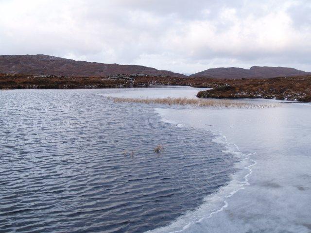Ice-fringed lochan, Meall a' Bhainne.