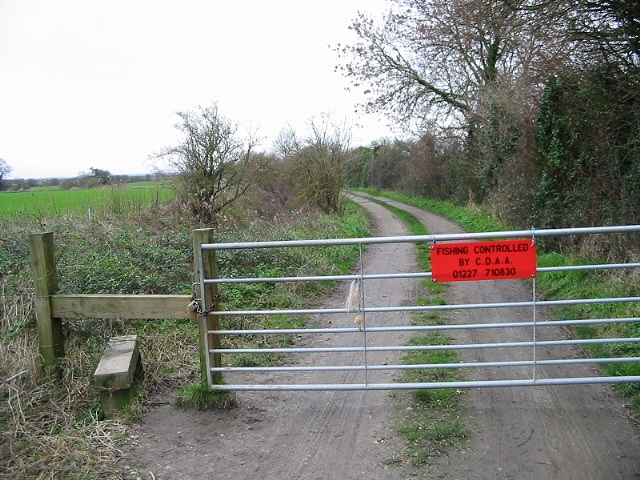 Gate across track leading to fishing lakes.